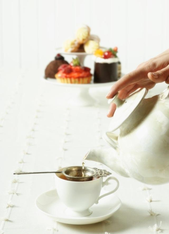Hand Pouring Tea